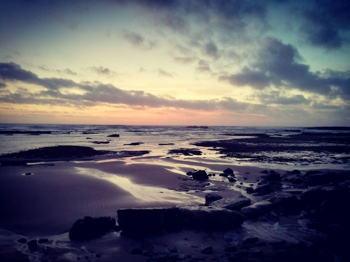 Pôr do Sol. Sea Sunset Beach Cloud - Sky Sky Scenics Dusk Water No People Nature Horizon Over Water Landscape Tranquility Beauty In Nature Outdoors Travel Destinations Sand Wave Day Low Tide