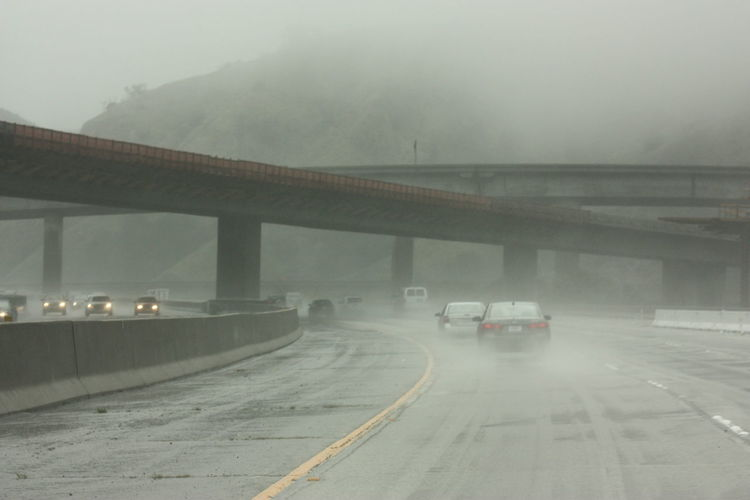 STORMY HIGHWAYS Architecture Bridge - Man Made Structure California Connection Day Fog Land Vehicle Mountains And Sky Nature No People Outdoors Road Sky Storm Highway Freeway Stormy Weather Transportation Winter Storm Slippery Roads Wet Wet Road