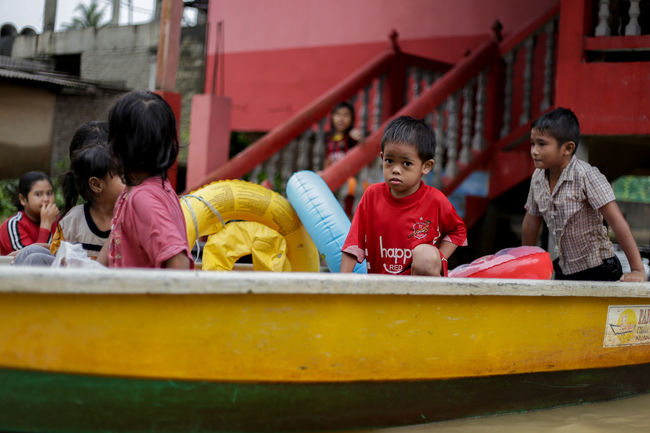 flood victims at kelantan Boys Cheerful Child Childhood Day Elementary Age Enjoyment Flood Victims Friendship Fun Girls Happiness Leisure Activity Lifestyles Outdoors People Playing Real People Smiling Togetherness