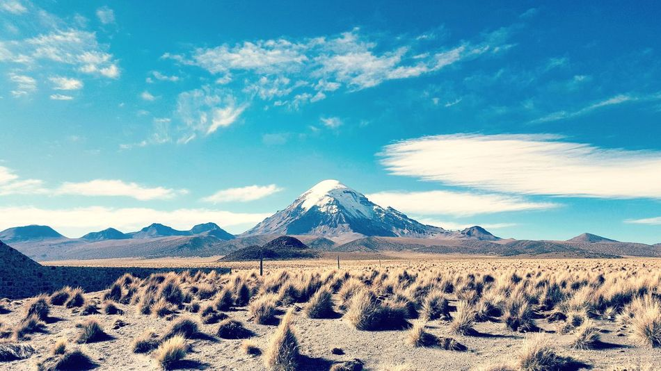 clean view of The Sajama mountain Sajama Mountain Volcano Sky Blue Bolivia Lonely Landscape South America Clouds And Sky EyeEm Selects Pyramid Triangle Shape Mountain Sand Cloud - Sky Sky Travel Destinations Travel Outdoors No People Nature Beauty In Nature Scenics Desert History Day