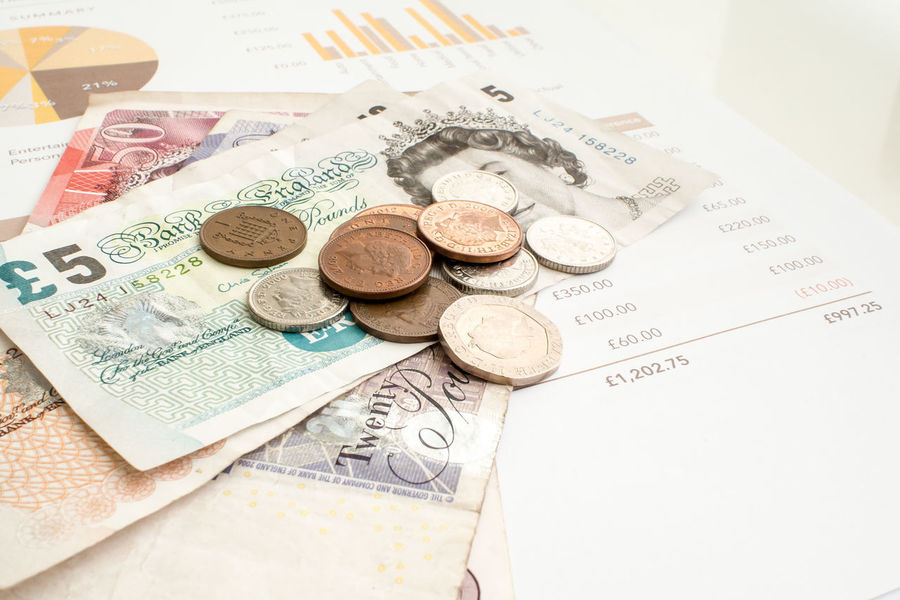 Monthly Budget concept with Pound Sterling paper money and coins. British Budget Close-up Coin Coins Currency Day England Finance Money No People Paper Currency Planning Pound Pound Sterling Savings Shillings And Pence Sterling United Kingdom Wealth