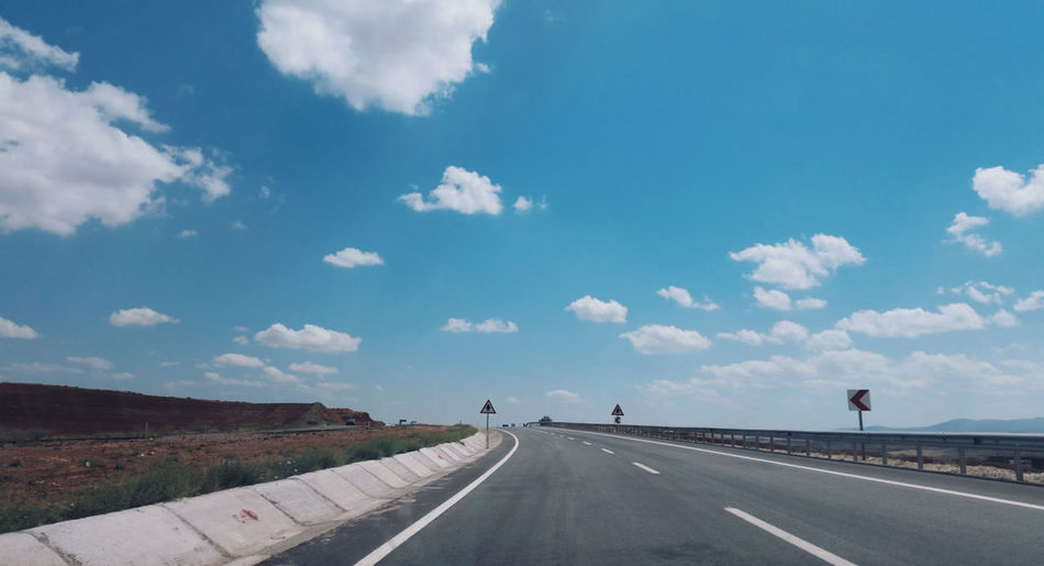 View of highway against blue sky