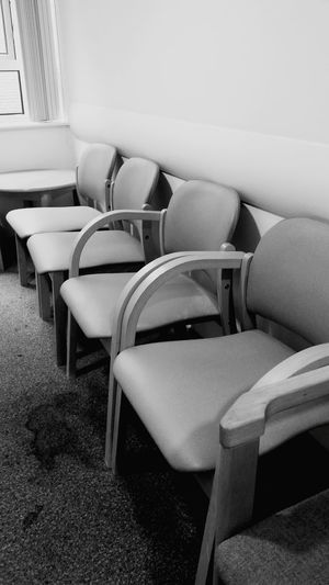 The Elusive Waiting Room In A Row Indoors  Chair Close-up Order Seat Group Of Objects Conformity Arranged Repetition No People