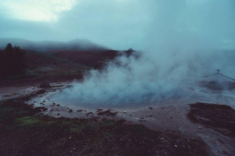 Steam emerging fro geyser