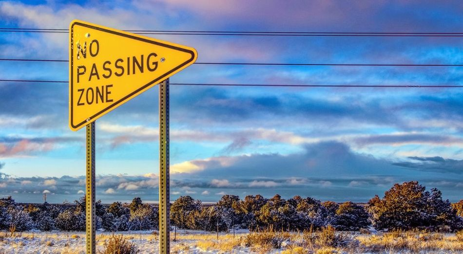 ROADSIGN Roadtrip Holiday Dream Skyline Poster Sign Communication Sky Cloud - Sky Road Sign Text Inner Power Warning Sign No People Nature Guidance Fence Day Road Western Script Security Outdoors Boundary Barrier Protection Safety Capture Tomorrow