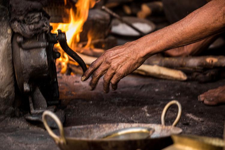 Close-up of blacksmith working at workshop