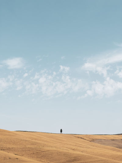 Scenic view of a tuscanian hill against sky