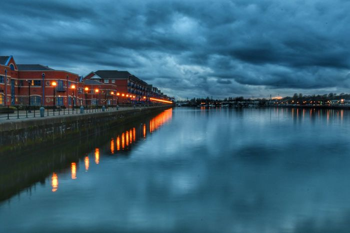 Walking the dog around Preston Marina on a beautiful spring evening. Reflection Cloud - Sky Illuminated Beauty In Nature Architecture Atmospheric Mood Malephotographerofthemonth Photography Is My Escape From Reality! Nikon Photography Nikon Long Exposure Blurred Motion Tranquility Preston Docks Waterfront Commercial Dock Marina Horizon Over Water
