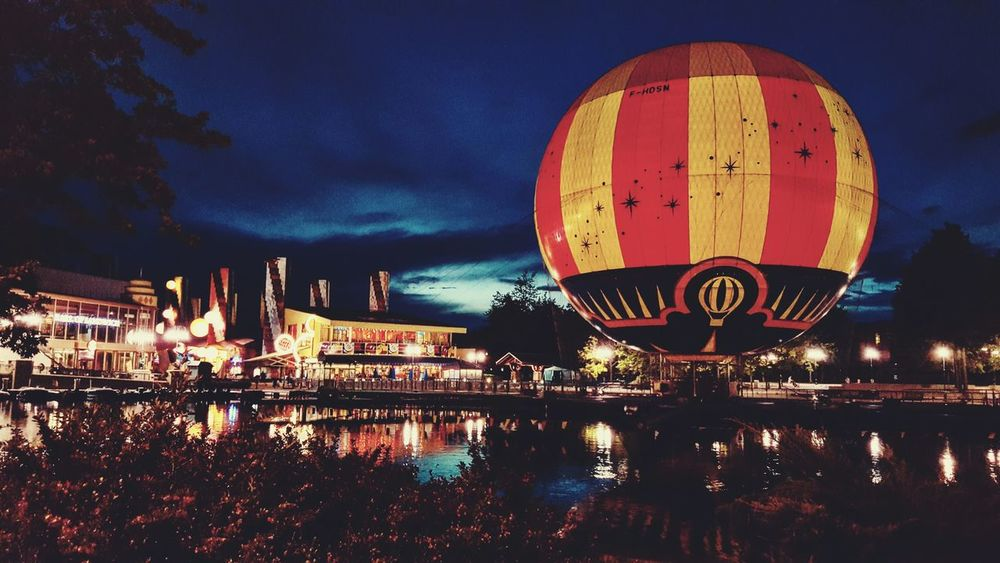 Night Sky Outdoors Illuminated No People Cityscape Architecture City Hot Air Balloon Disneyland Paris Disney Disneyland Paris Marnelavallee France Dream Drug Good Times Water Disneyvillage Childdreams First Eyeem Photo