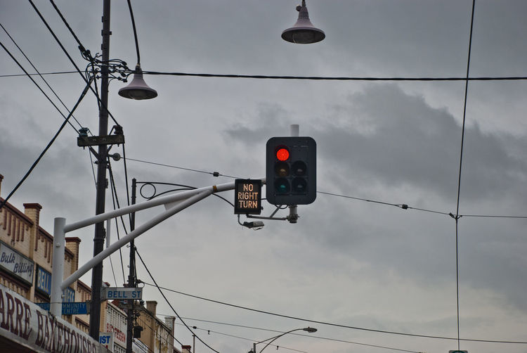 Low Angle View Of Traffic Signal Against Sky In City