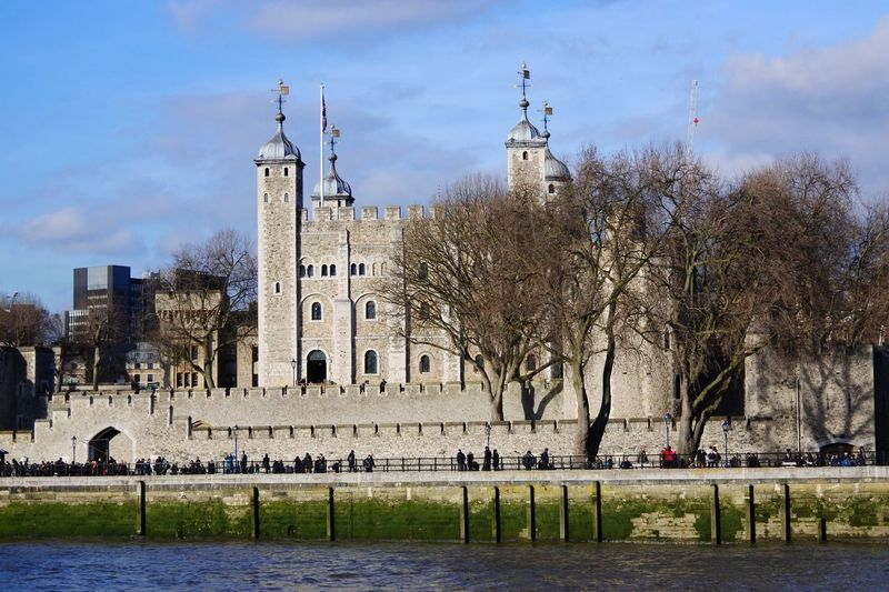 The Tower of London- history Building Exterior Architecture Tree Built Structure City Travel Destinations Outdoors Sky History Water Day Religion Bare Tree No People Nature Historic Historical Building London Architecture Historical Famous Place Waterfront Infamous Tourism Travel