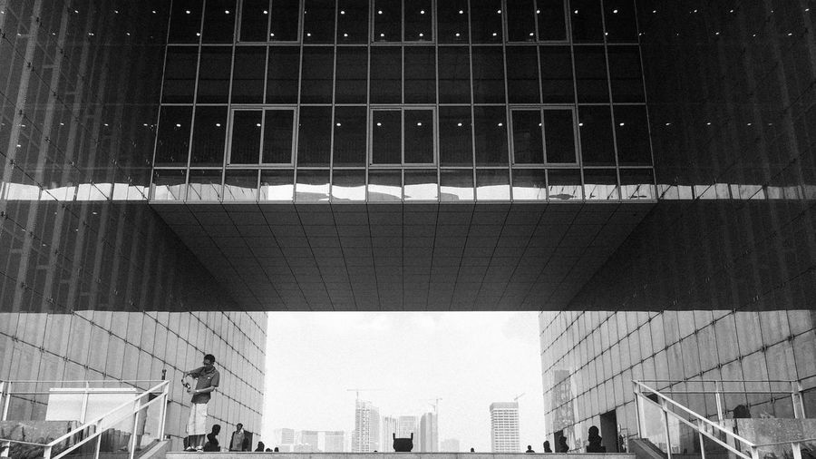 Library Black And White City Built Structure Architecture Men Low Angle View Modern City Life Building Story