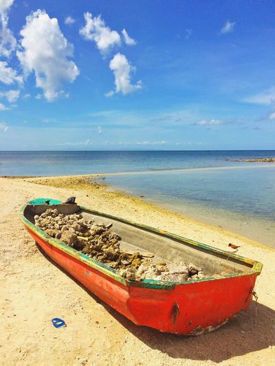 Boat Filled With Stones On Beach