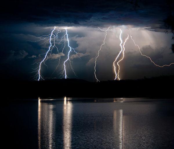 Reflection Of Lightning On Lake At Night