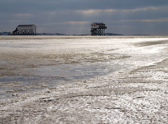 Sankt Peter Ording beach, snow in february Sky Land Water Sea Scenics - Nature Beach Nature Built Structure Cloud - Sky Beauty In Nature Architecture Building Exterior Tranquil Scene No People Tranquility Outdoors Pier Day Horizon Over Water