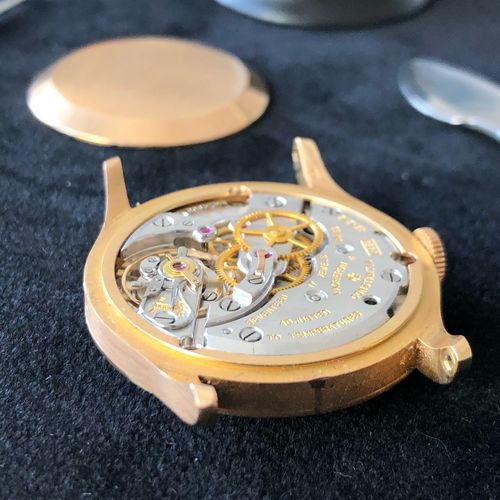 Close-Up Of Wrist Watch Machinery On Table