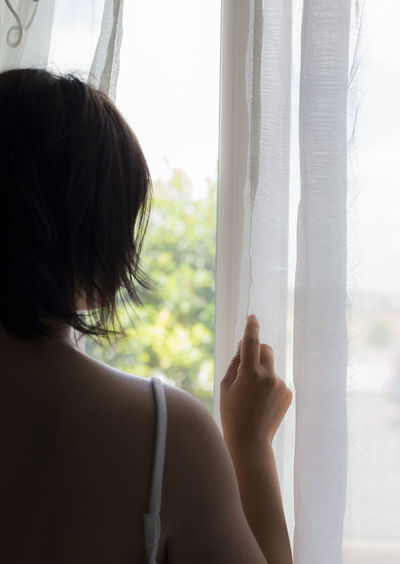Morning Morning Light Adult Contemplation Day Hand Human Hand Indoors  Lifestyles Looking One Person Rear View Window Women Young Adult Young Women A New Beginning