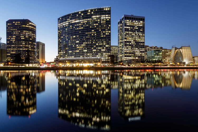 Downtown Oakland and Lake Merritt Reflections at Twilight. Oakland, Alameda County, California, USA. Reflection Architecture Building Exterior City Illuminated Water Built Structure Building Sky Travel Destinations Modern Office Building Exterior Cityscape City Life Skyscraper Waterfront Outdoors Financial District  Lake Merritt Oakland Downtown District Twilight San Francisco Bay Area Blue Califoria
