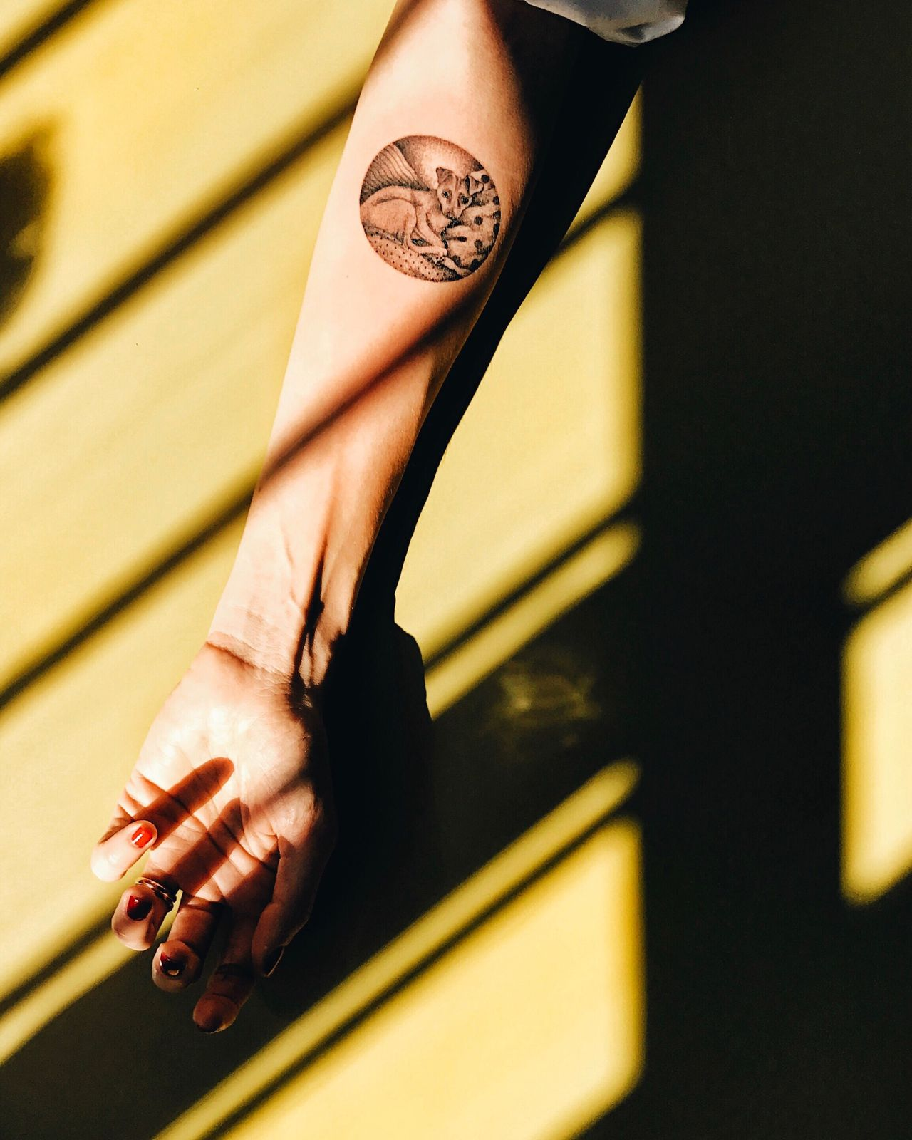 Cropped hand of woman showing tattoo