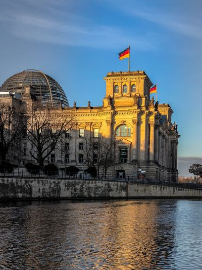 Reflections in Berlin Germany Berlin Reflection Architecture Built Structure Building Exterior Sky Dome Flag Waterfront History Travel Destinations Outdoors Water No People