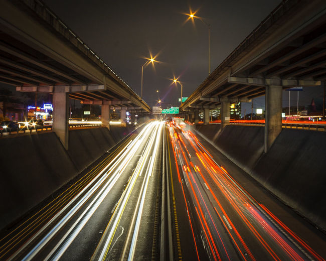What comes in, must come out Architecture Bridge - Man Made Structure Building Exterior Built Structure Car City Connection Illuminated Land Vehicle Light Trail Long Exposure Motion Night No People Outdoors Road Sky Speed The Way Forward Traffic Transportation The City Light