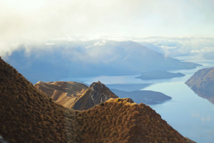 One of the best hiking tracks in New Zealand the Roys Peak Sun Sunset Grass Blue Lookout Scenics View Beautiful Alpine Sport Windy Cloud Travel Wanderlust New Zealand Mountains Hiking Roys Peak Mountain No People Landscape Aerial View Scenics Lake Outdoors Water Nature Beauty In Nature Day