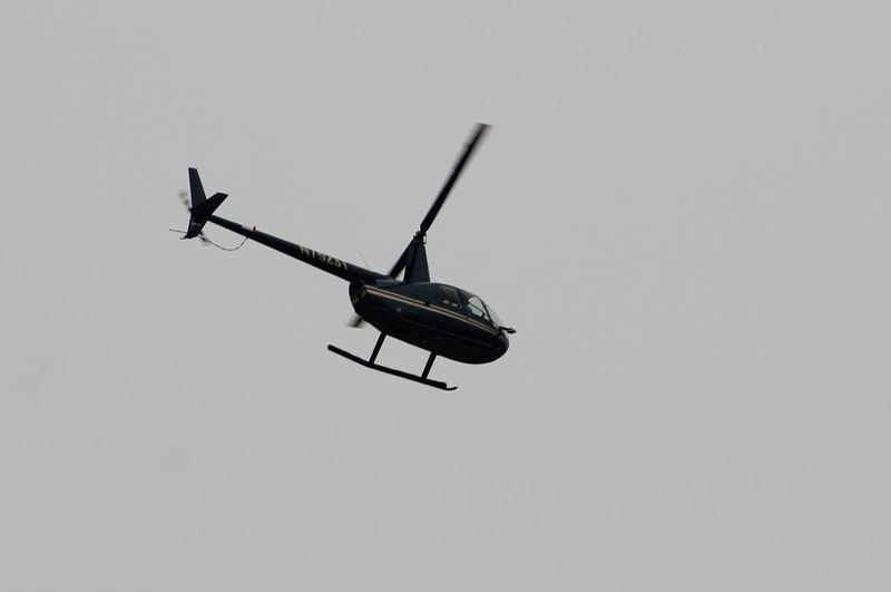 Helicopter Watching for sharks Air Vehicle Helicopter Helicopter Low Angle View Oceanside Beach Outdoors Sea And Sky Transportation Watching For Sharks