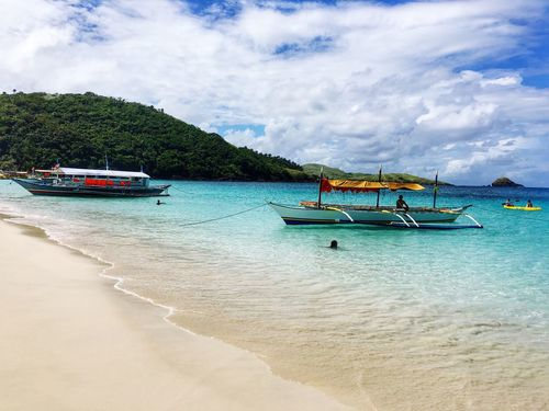 Life's a beach. RrPhotos Calaguas, Philippines Itsmorefuninthephilippines Philippines Calaguas Beachlife Summer White Sand Beach Boat Sand Sun Sea EyeEm Best Shots The Great Outdoors - 2018 EyeEm Awards