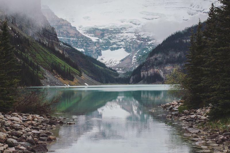 Serene waters of Lake Louise Lake Louise,Alberta Lake Tranquility Canada Banff National Park  Mountains Vacations