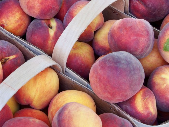 Close-up of peaches in basket