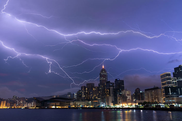 Lightning in Hong Kong City during Night Time Hong Kong Harbor Thunderstorm Thunder Cityscape City View  Urban Urban View Skyline Landscape Stormy Flash Skyscrapers Climate Outdoors Nature Strike Light Rainstorm Night Time Nightmare Dangerous Buildings Lightning Town