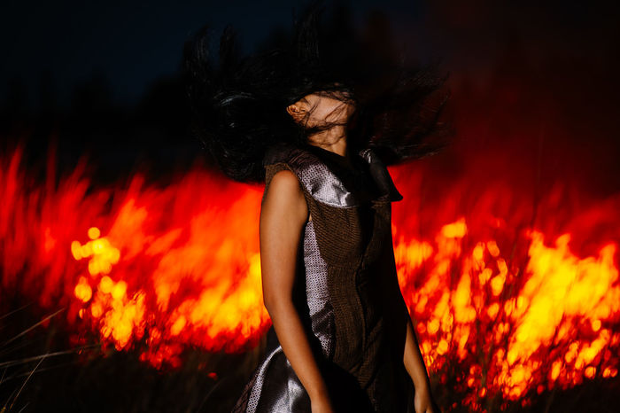 Blaze Casual Clothing Dress Fire Fire - Natural Phenomenon Flame Heat - Temperature Leisure Activity Lifestyles Long Hair Orange Color Outdoors Person Red Sensuality Showcase April Side View Silhouette Standing Three Quarter Length Young Adult 43 Golden Moments Original Experiences Let Your Hair Down Feel The Journey