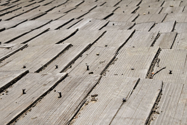 Full frame shot of vintage wooden roof planks with nails