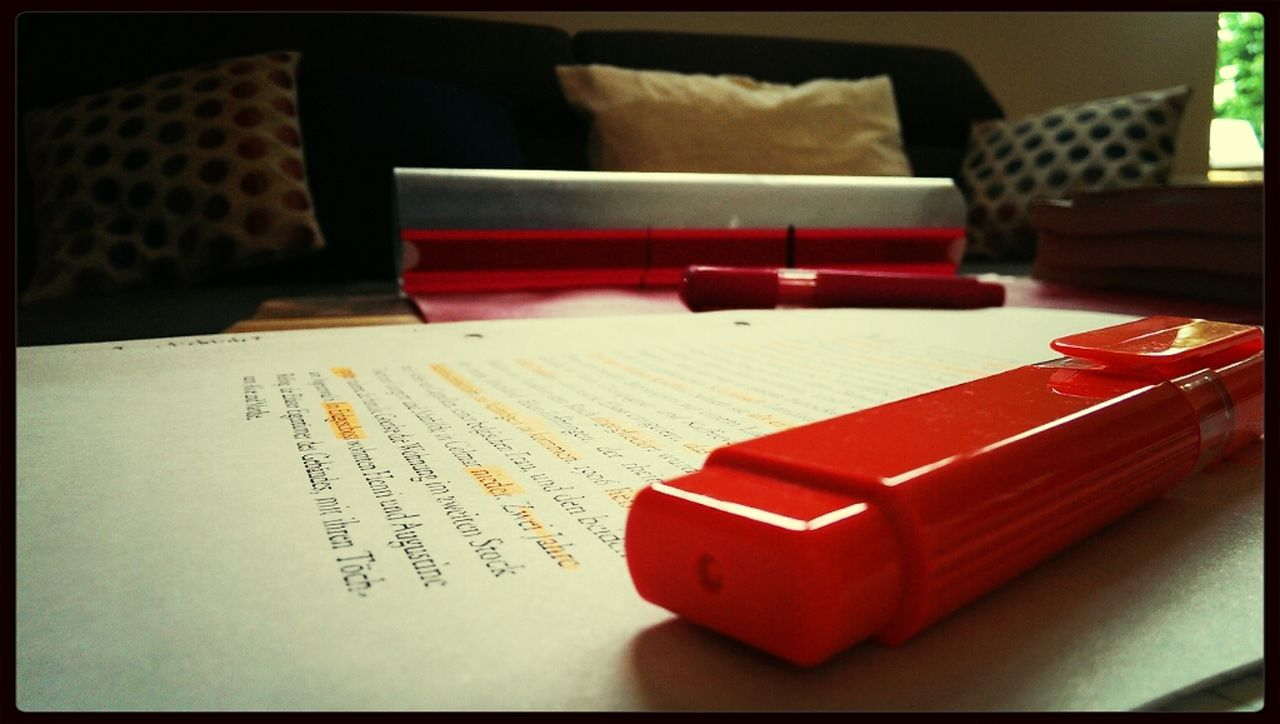 table, indoors, red, text, book, no people, communication, paper, close-up, day