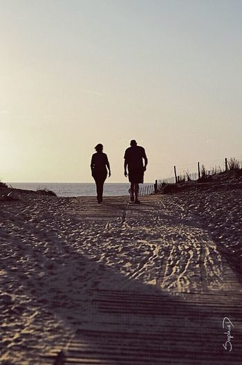 Week-end Beach Sea Togetherness Sky Silhouette Outdoors Walking Tranquility Beauty In Nature Sunset