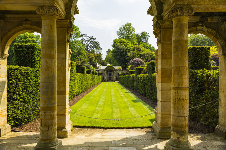 Hever Gardens, Hever Castle & Gardens, Hever, Edenbridge, Kent, England, United Kingdom Ancient Ancient Civilization Arch Architectural Column Architecture Building Exterior Built Structure Day Grass History Nature No People Old Ruin Outdoors Sky Travel Destinations Tree