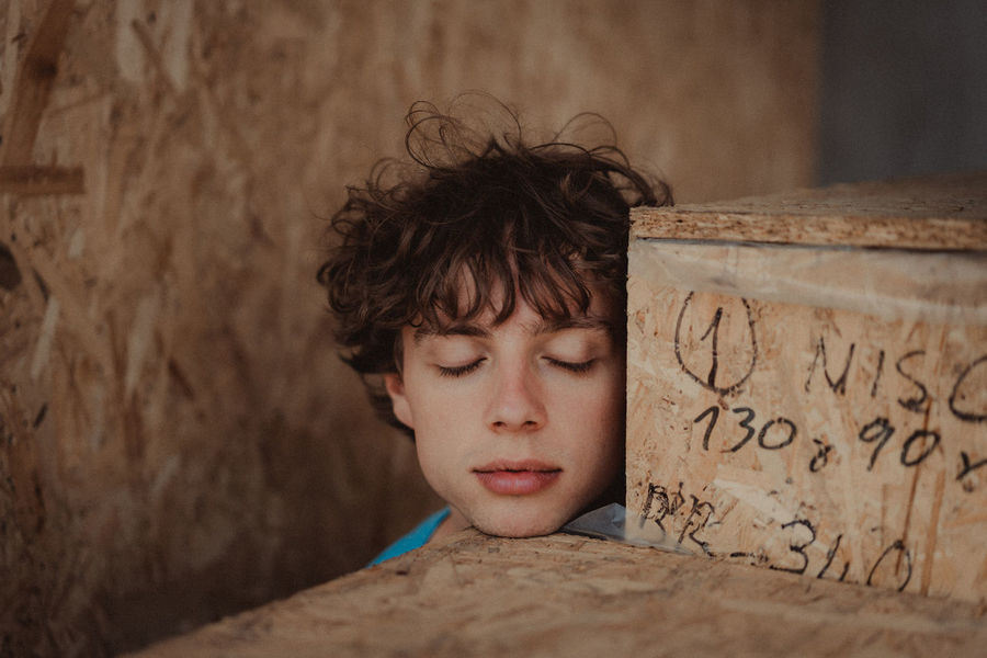 Boys Child Childhood Communication Day Focus On Foreground Headshot Innocence Leisure Activity Lifestyles Looking Males  One Person Portrait Pre-adolescent Child Real People Teenager Text Wall - Building Feature Western Script