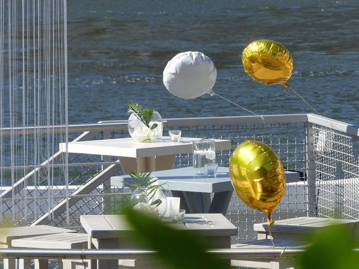 Boat Party Happiness Railing Architecture Balloons Celebration Event Golden Balloons No People Outdoors Party Party - Social Event Railing River Summer Sunlight Table With Flowers Water Waterfront White And Green White Balloons