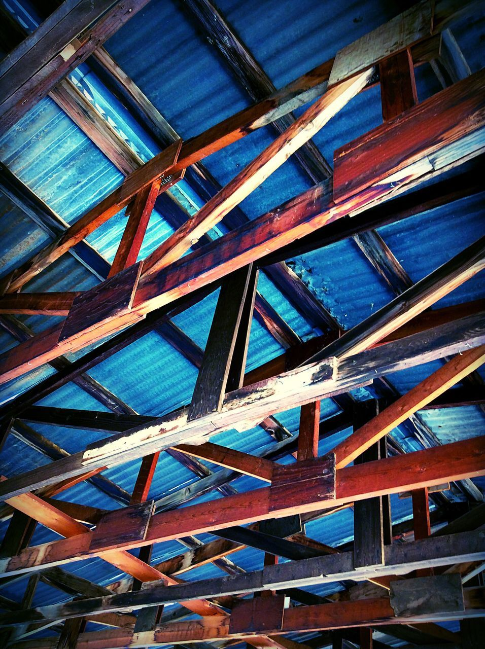 low angle view, architecture, built structure, wood - material, day, pattern, no people, indoors, backgrounds, building exterior, close-up