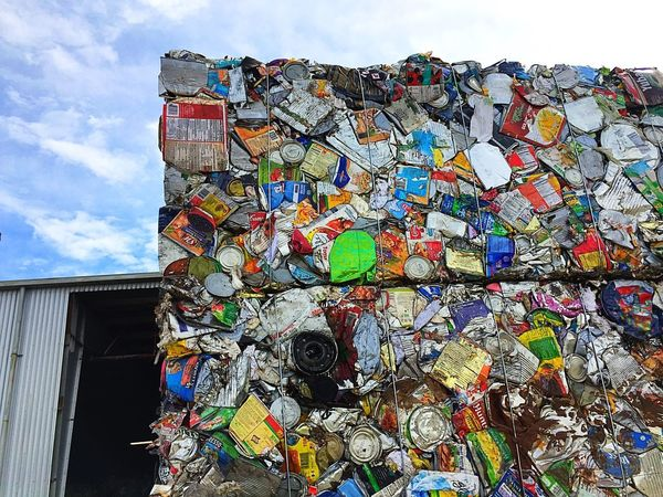 Wall of recycled plastics Recycling Center Garbage Dump Dump Recycling Multi Colored Built Structure Sky Day Architecture No People End Plastic Pollution Building Exterior Low Angle View Pattern