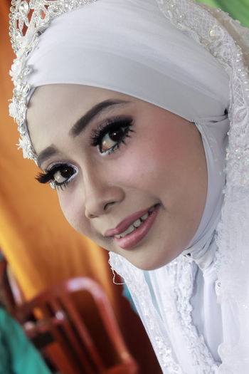 Close-up portrait of bride with make-up during wedding ceremony