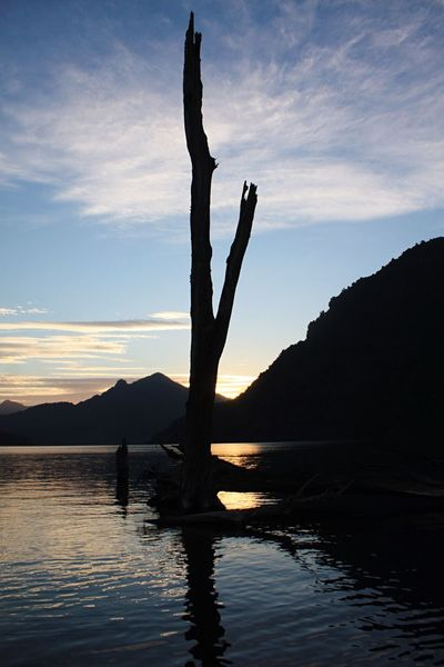 Nature Water Sky Silhouette Beauty In Nature Nature Tranquil Scene Scenics Tranquility Blue Chile Planet Earth Freshness Enjoyment Beauty In Nature Sunset Mountain Sea Outdoors One Person Waterfront Leisure Activity Real People Men Day