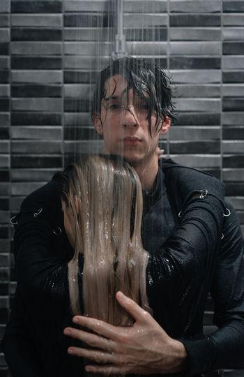 Portrait of man embracing female partner in shower