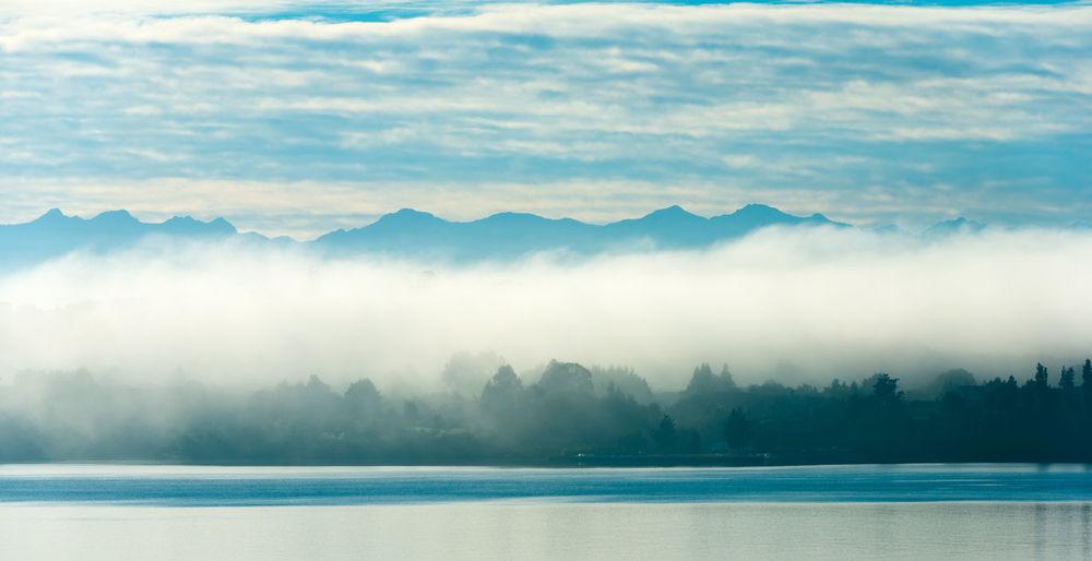 Morning fog over puerto varas on the shores of lake llanquihue, x region de los lagos, chile