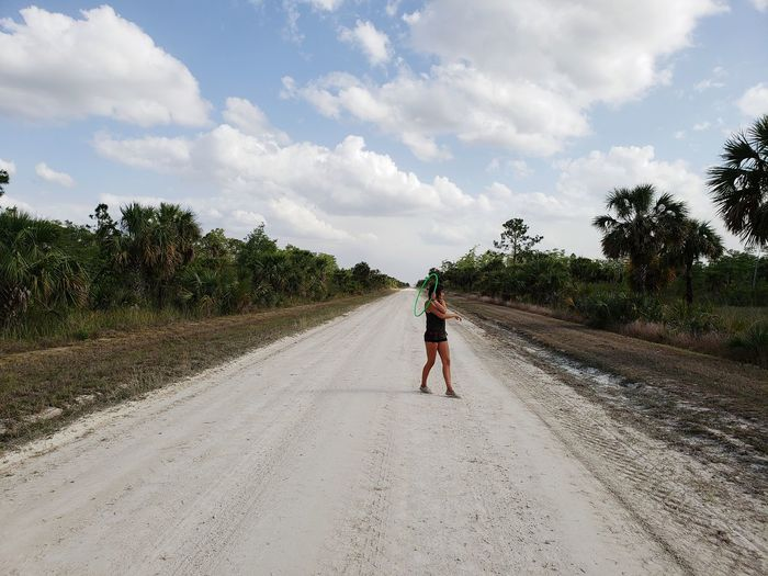 Everglades  Nature Wildlife Leaves Branch Green Hula Hooping  One Person One Woman Tree Full Length Agriculture Men Working Sky Cloud - Sky Empty Road vanishing point Diminishing Perspective Passageway Passing Pathway Leading Treelined The Way Forward Country Road Hiker Visual Creativity EyeEmNewHere Going Remote Focus On The Story Adventures In The City