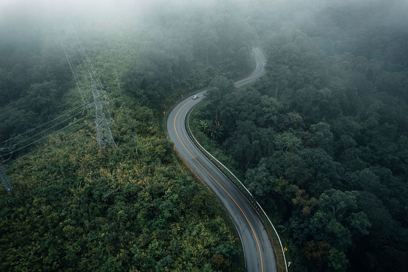High angle view of mountain road in forest