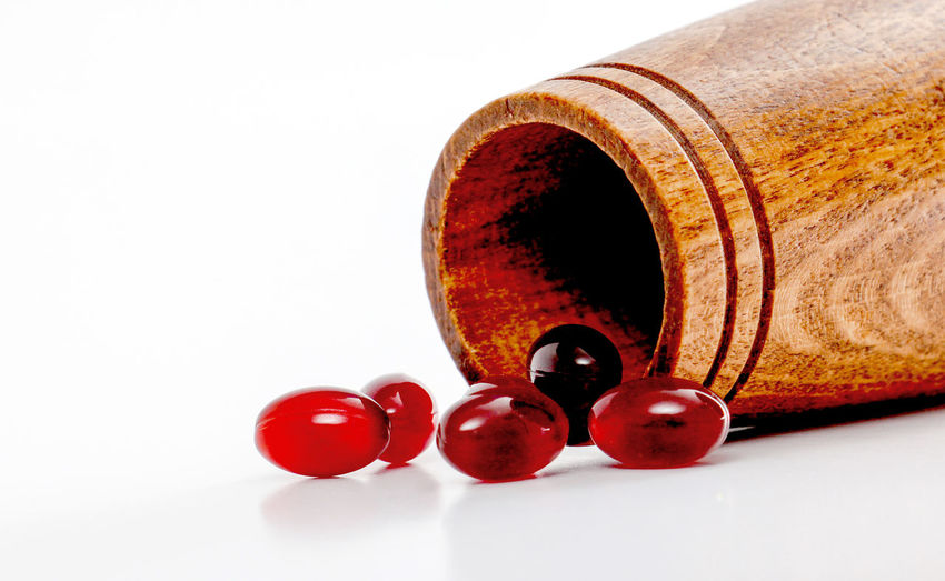 omega 3 Antioxidant Can Capsule Close-up Cod Liver Oil Fish Oil Krill No People Omega Omega 3 Pouring Out Red Red Red Capsule Supplements Vitamin D White Background Wood
