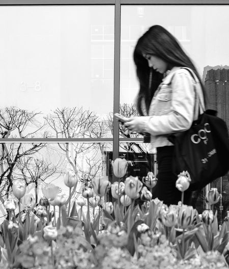 The Moment - 2015 EyeEm Awards Streets Of Seoul Urban Lifestyle People With Smartphones Spring Springtime Fashion Forever My Smartphone Life The Photojournalist - 2015 EyeEm Awards The Fashionist - 2015 EyeEm Awards Spring Flowers Tulips Window Reflection Blurry Women Who Inspire You Human Meets Technology Mobile Conversations
