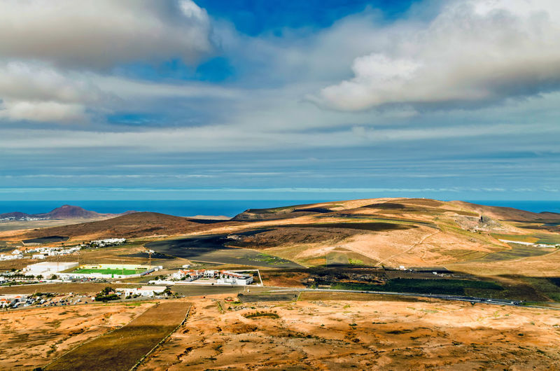 scenic view of the landscape of the island of Lanzarote against sky Sea Beach Water Rural Scene Sky Horizon Over Water Landscape Cloud - Sky My Best Photo