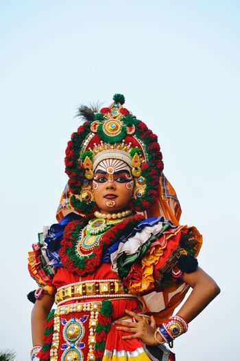 Portrait of woman in costume standing against clear sky